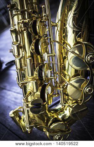 Closeup detail of a golden alto saxophone