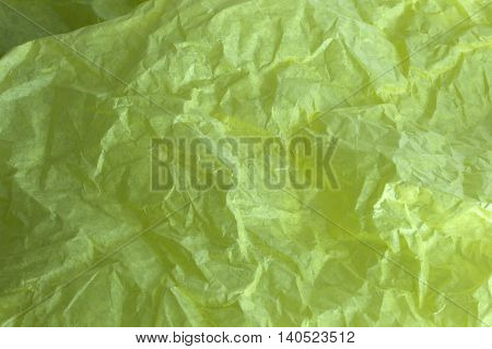 This is a photograph of Yellow tissue paper background