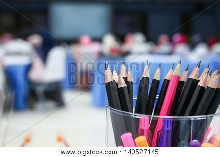 Close up Black pencil in box, Wooden pencil collection and blur business meeting