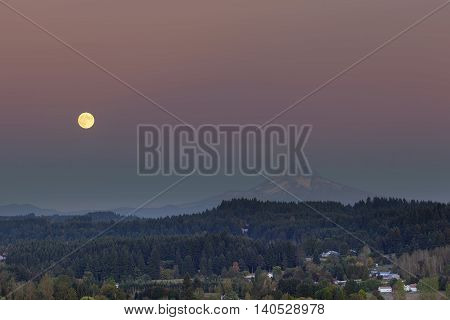 Full moon rising over Mt Hood after sunset in Happy Valley Oregon