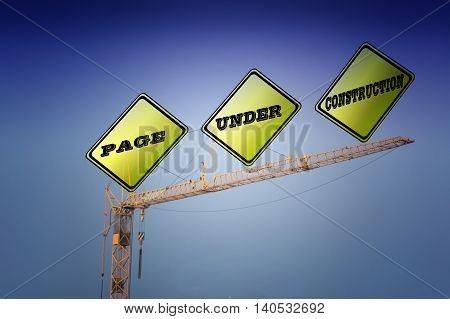 Large yellow signs on a construction crane that says