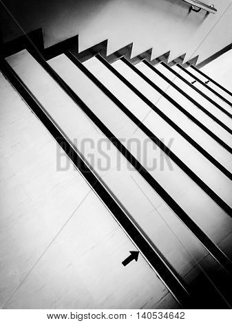 Arrow at staircase. Black and white. Abstract