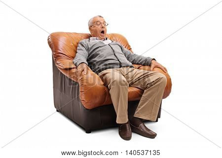 Scared senior with a terrified facial expression sitting on an armchair isolated on white background