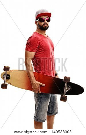 Vertical shot of a young bearded man holding a longboard isolated on white background
