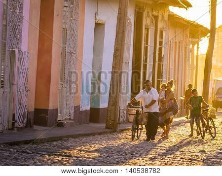 Trinidad, Cuba on December 29, 2015: The warm sunset light shines on the streets of the city centre in the Cuban city of Trinidad, a unique Latin American city in the Caribbean