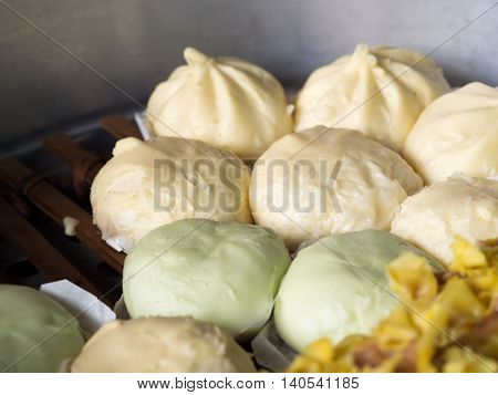Local Chinese food steamed dumplings or steamed buns steaming in pot. (selective focus)