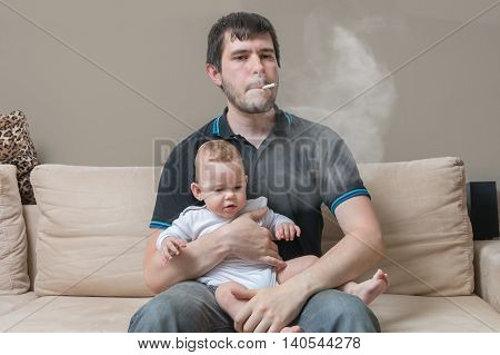 Bad Parent - Smoking Father Is Holding Baby In Hands.