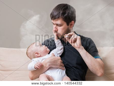 Bad Father Is Smoking And Holding Little Baby In Hands.