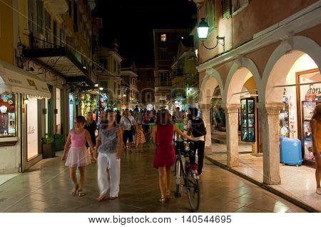 CORFU-AUGUST 25: Crowd of tourists on Kerkyra street at night on August 25 2014 in Kerkyra town on the Corfu island Greece.