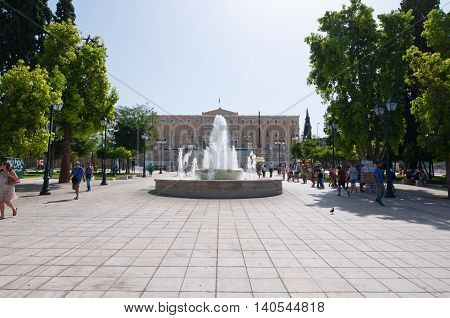 ATHENS-AUGUST 22: Syntagma Square and Parliament building on the background on August 22 2014 in Athens Greece.