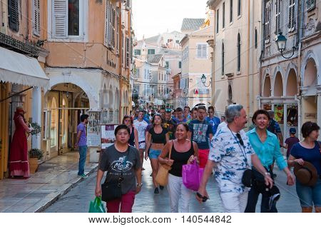 CORFU-AUGUST 22: Kerkyra old town in the evening with the row of souvenirs shops on August 22 2014 on Corfu island Greece.