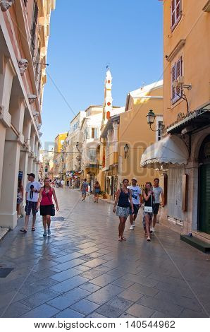 CORFU-AUGUST 22: Kerkyra narrow street in the hot weather with the row of souvenirs shops on August 22 2014 on Corfu island Greece.