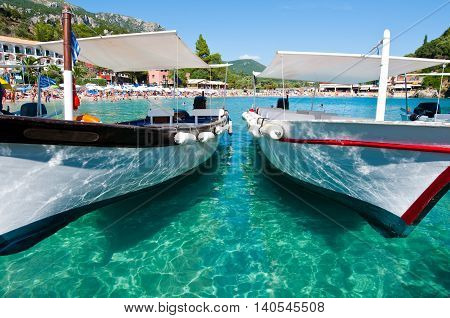 CORFU-AUGUST 26: Palaiokastritsa beach with boats on the water on August 262014 on the island of Corfu Greece. Palaiokastritsa is a village with famous beaches in the North West of Corfu.