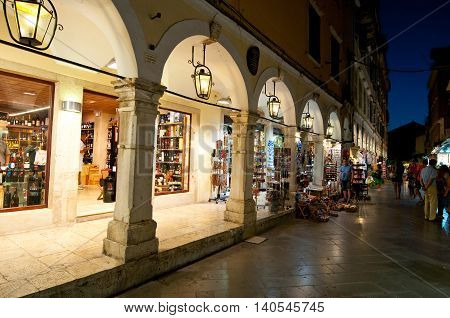 CORFU-AUGUST 27: Kerkyra old town with the row of souvenirs shops on August 27 2014 on Corfu island Greece.