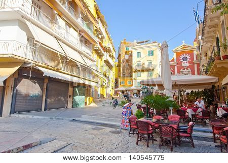 CORFU-AUGUST 22: Kerkyra street with facade of the Metropolitan Church on the background on August 22 2014 on CorfuGreece. Inside the church the relics of St. Theodora are kept in a silver shrine.