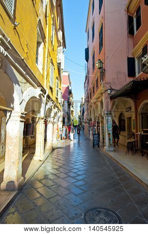CORFU-AUGUST 27: Kerkyra narrow street in the old town with the row of souvenirs shops on August 27 2014 on Corfu island Greece.