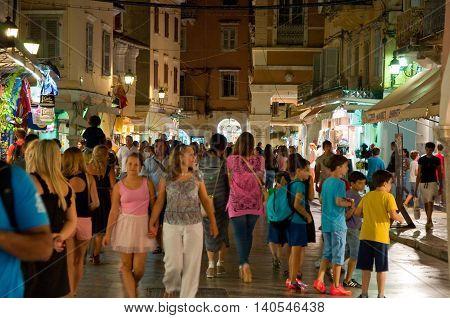 CORFU-AUGUST 25: Kerkyra busy street at night with crowd of people on August 25 2014 in Kerkyra town on the Corfu island Greece.