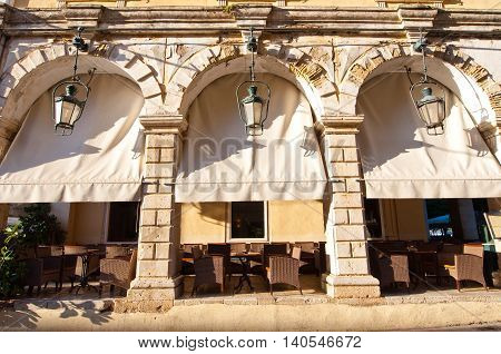 Cosy cafe in of a typical Venetian building in Kerkyra city on the island of Corfu Greece.
