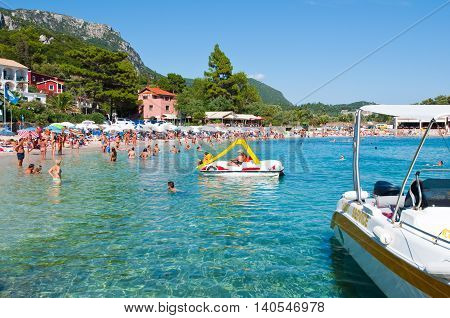 CORFU-AUGUST 26: Sandy Palaiokastritsa beach on August 262014 on the island of Corfu Greece. Palaiokastritsa is a village with famous beaches in the North West of Corfu.