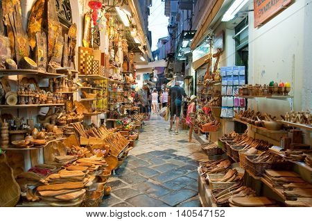 CORFU-AUGUST 24: Tourists go shopping in local souvenirs shops on August 242014 on Corfu island Greece.