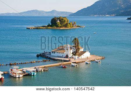 Close up Vlacheraina monastery as seen from the hilltop of Kanoni on the island of Corfu Greece. poster