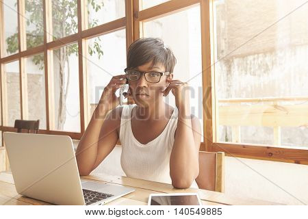 Young Attractive African American Woman Psychologist With Short Haircut, Talking On Phone To Her Pat