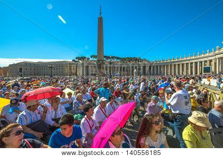 Rome, Italy - June 18, 2016: people sitting while you listen to Pope Francesco speaking for jubilee event in St. Peter's Square, Vatican.