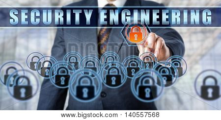 Torso of manager in steel blue business suit is touching SECURITY ENGINEERING on a transparent interface. Business metaphor and information technology concept for crime prevention and cryptography.
