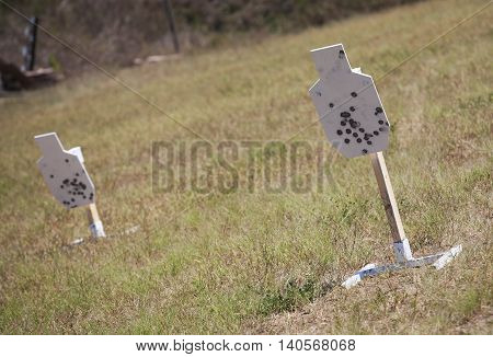 Steel targets that are used for firearm practice down range
