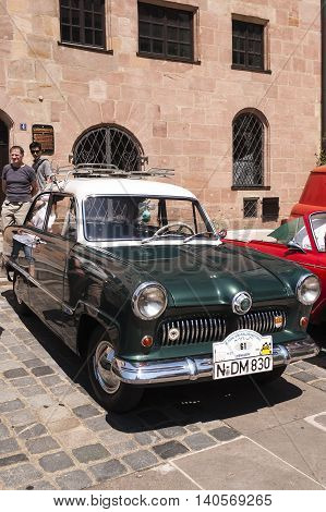 Nurnberg Bavaria / Germany - July 19th 2014: green vintage car at Sud - Rallye- Historic event in Nurnberg