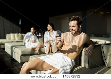 Young Man In The Room With Mobile Hone