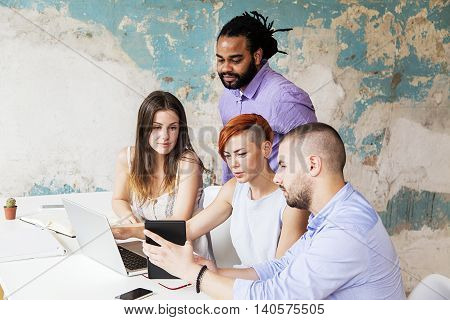 Young People Working In The Grunge Office