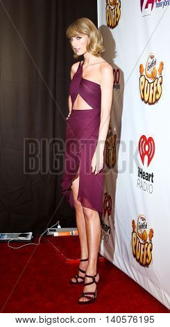 NEW YORK-DEC 12: Singer Taylor Swift attends Z100's Jingle Ball 2014 at Madison Square Garden on December 12, 2014 in New York City.