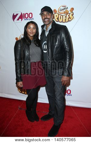 NEW YORK-DEC 12: Former NBA player Rick Fox (R) and daughter Sasha attend Z100's Jingle Ball 2014 at Madison Square Garden on December 12, 2014 in New York City.