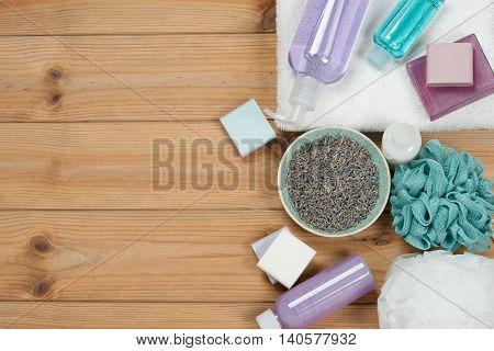 Toiletry Set. Soap Bar And Liquid. Dried Lavender Petals. Shampoo, Shower Gel Body Milk, Towel. Spa Kit. Top View