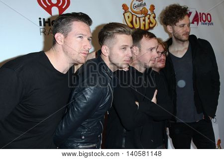 NEW YORK-DEC 12:(L-R) Zach Filkins, Ryan Tedder, Eddie Fisher, Drew Brown and Brent Kutzle of OneRepublic attend Z100's Jingle Ball 2014 at Madison Square Garden on December 12, 2014 in New York City.