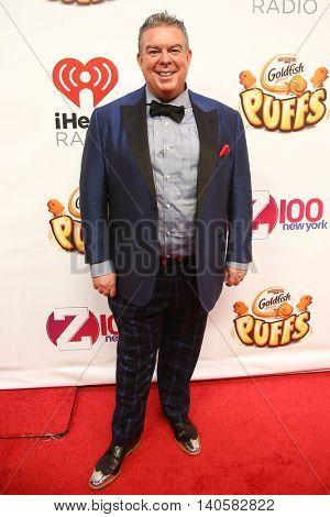 NEW YORK-DEC 12: Radio host Elvis Duran attends Z100's Jingle Ball 2014 at Madison Square Garden on December 12, 2014 in New York City.