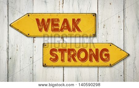 Direction Signs On A Wooden Wall - Weak Or Strong
