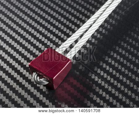 Red nut and wire that is used for recreational climbing