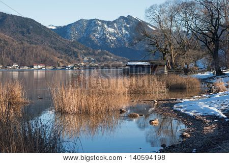 Idyllic Lake Shore With Boathouse, At The End Of Winter
