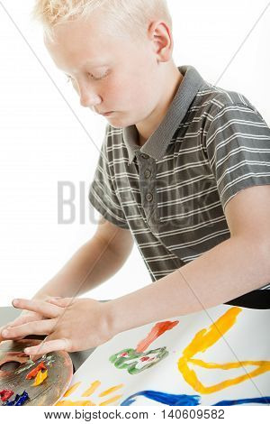 Young Blond Boy Painting With His Fingers