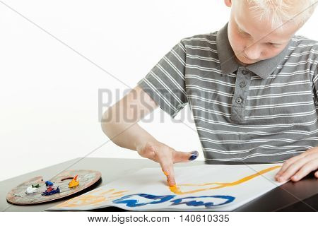 Young Boy Artist Doing Finger Painting
