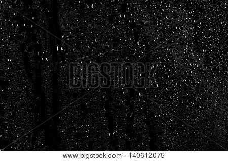 Drops Of Water On A Dark Glass