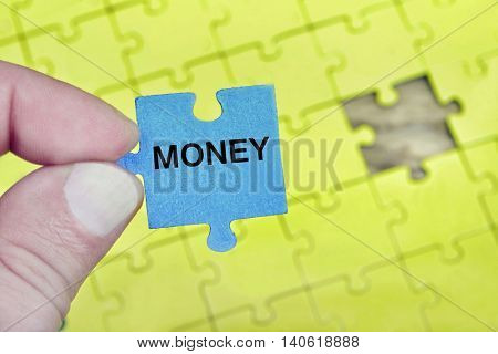 Puzzle pieces with word Money