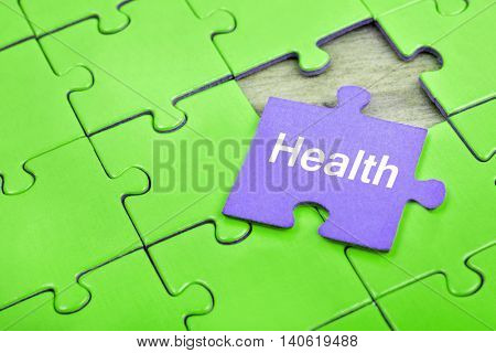 Puzzle pieces with word Health
