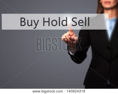 Buy Hold Sell - Businesswoman Pressing High Tech  Modern Button On A Virtual Background