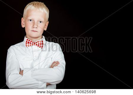 Serious Boy With Red Dotted Bow Tie Starring