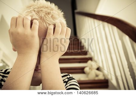 Close Up Of Child With Hands Against His Face