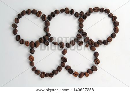Coffee beans in a circles. Rings made of coffee beans.
