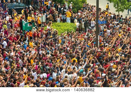 CLEVELAND OH - JUNE 22 2016: Massive crowds cheer and wave in adulation as the NBA champion Cavaliers ride by in their victory parade in downtown Cleveland.